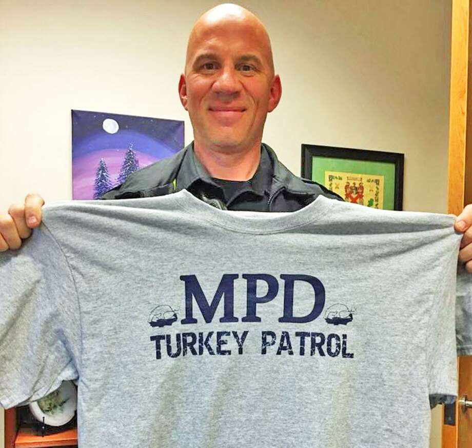 Middletown Police Community Relations Officer Anthony Knapp purchased T-shirts for community volunteers to wear during the turkey drives this weekend at Stop & Shop on East Main Street in Middletown. Photo: Courtesy Middletown Police