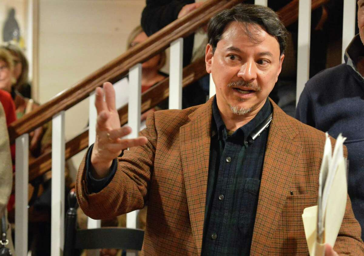 Bill Kraus talks about all who helped save and restore Fodor Farm during a reception and gallery opening at the property in Norwalk on Thursday.
