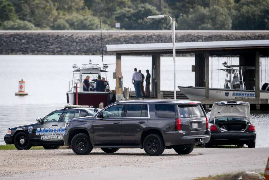 Law enforcement investigate a body that was discovered on Lake Conroe on Friday, Nov. 17, 2017, at the Precinct 1 Constable's Office lake office. Staff photo by Michael Minasi
