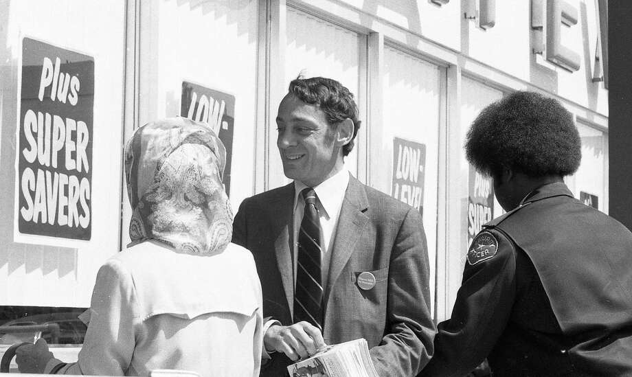 May 21, 1976: Harvey Milk passes out fliers at a San Francisco Safeway grocery store during his 1976 State Assembly run. Photo: Joe Rosenthal, The Chronicle