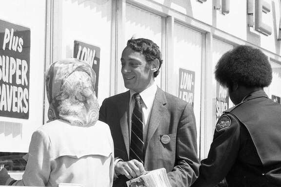 May 21, 1976: Harvey Milk passes out fliers at a San Francisco Safeway grocery store during his 1976 State Assembly run.