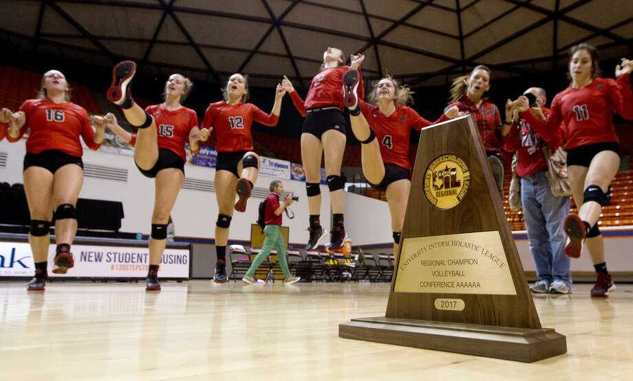 The Woodlands leap into the air as they sing the school song after defeating College Park 3-1 during a Region II-6A final volleyball match at Johnson Coliseum, Saturday, Nov. 11, 2017, in Huntsville. Photo: Jason Fochtman/Houston Chronicle