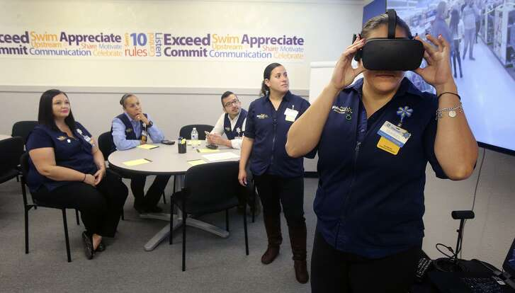 Walmart employee Isabel Reyes (right) experiences a Black Friday virtual reality scenario Friday November 10, 2017 at a San Antonio Walmart Training Academy. Walmart is currently using virtual reality technology to train and teach its employees about retail shopping scenarios for Black Friday and other notable shopping periods throughout the year.