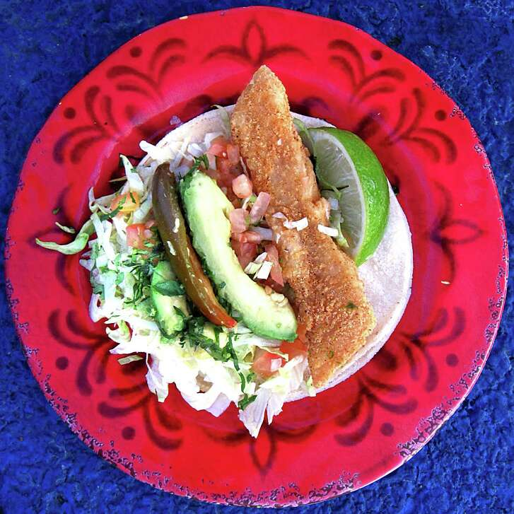 Fried fish taco on a corn tortilla from El Bucanero.