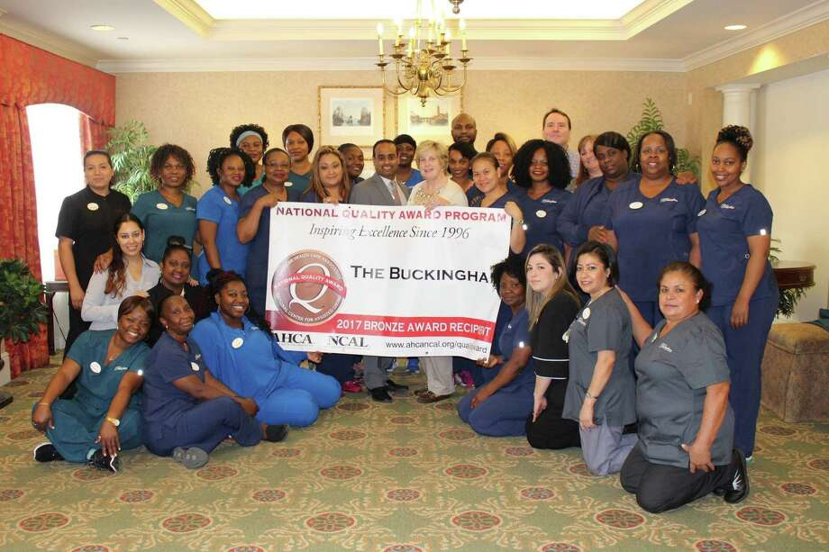 The Buckingham Health Services team celebrates the award.