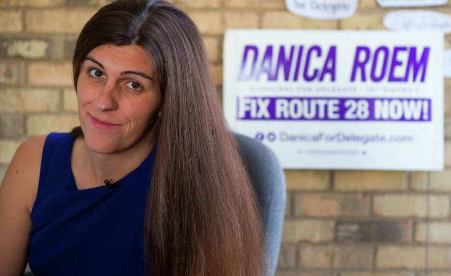 """(FILES) This file photo taken on September 22, 2017 shows Danica Roem, a Democrat for Delegate in Virginia's district 13, a transgender, at her campaign office on September 22, 2017 in Manassas, Virginia. A 33-year-old transgender Democrat was being lauded as a pioneer on November 8, 2017 after she won a seat in the Virginia state legislature against a Republican incumbent who openly boasted of being a """"homophobe.""""""""Discrimination is a disqualifier and the message of inclusion is a winning message,"""" Danica Roem, a former local newspaper reporter and singer in a heavy metal band, told AFP.""""It's humbling and I know I have a big responsibility right now -- get results,"""" Roem said in a telephone interview following her landmark victory.  / AFP PHOTO / Paul J. RICHARDSPAUL J. RICHARDS/AFP/Getty Images Photo: PAUL J. RICHARDS / AFP or licensors"""