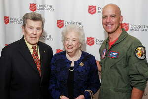 """Honorees William and Sally Slick, from left, with keynote speaker Major Dan Rooney at The Salvation Army """"Doing the Most Good"""" Luncheon at River Oaks Country Club."""