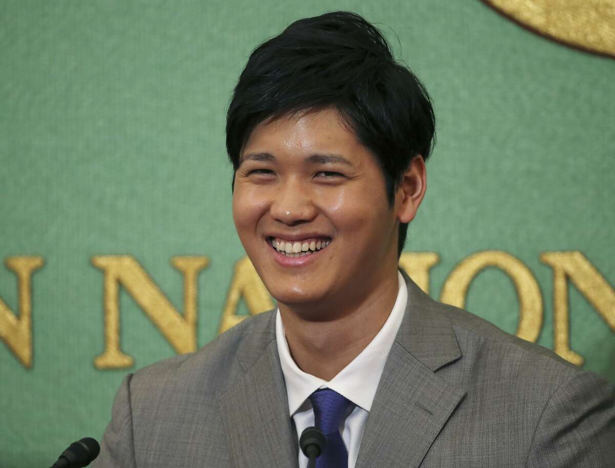 Japanese pitcher-outfielder Shohei Ohtani smiles during a press conference at Japanese National Press Center in Tokyo, Saturday, Nov. 11, 2017.