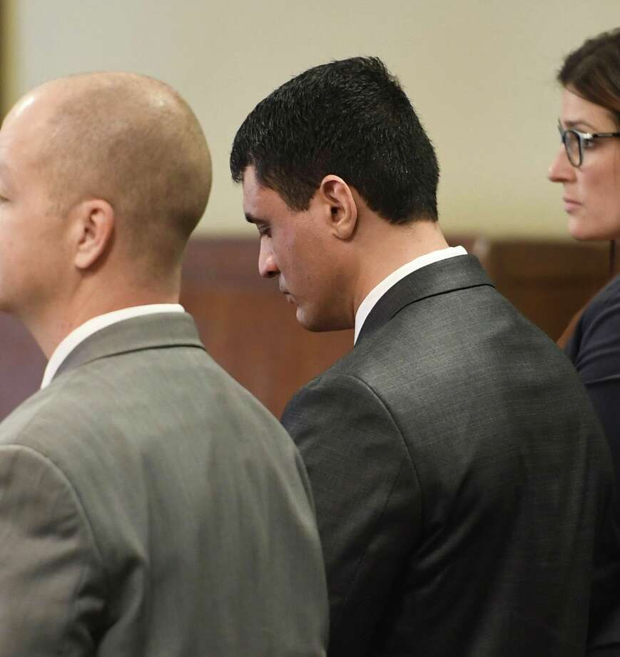 Johnny Oquendo bows his head after a Rensselaer County jury convicted him Friday of murdering his 21-year-old stepdaughter Noel Alkaramla. Photo: Skip / Times Union