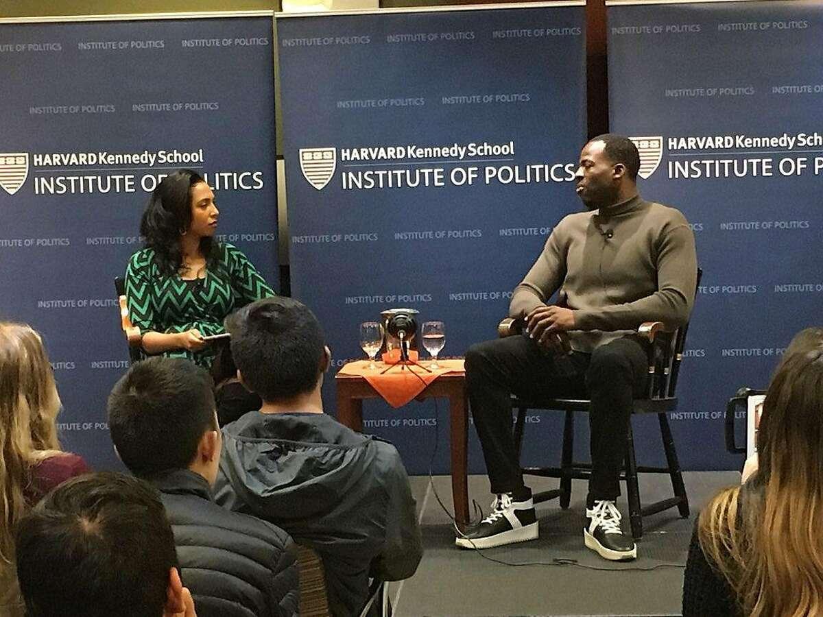 Cambridge, Ma: Golden State Warrior forward Draymond Green, r, speaks to a class at the Harvard Kennedy School/Institute of Politics. Steve Hewitt / Boston Herald