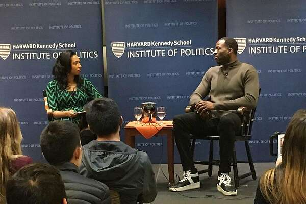 Cambridge, Ma: Golden State Warrior forward Draymond Green, r, speaks to a class at the Harvard Kennedy School/Institute of Politics. Steve Hewitt / Boston Herald