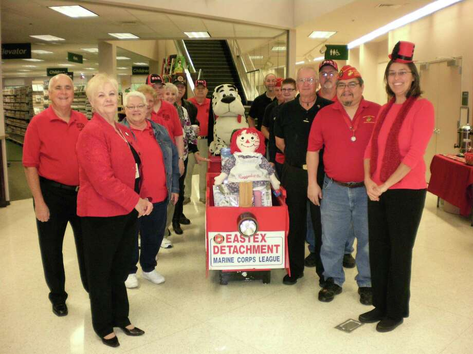 The Montgomery County Central Library staff at the kick-off for their Toys for Tots drive on Nov. 9. New, unwrapped toys may be dropped off at the MCMLS's seven branches through Dec. 15.