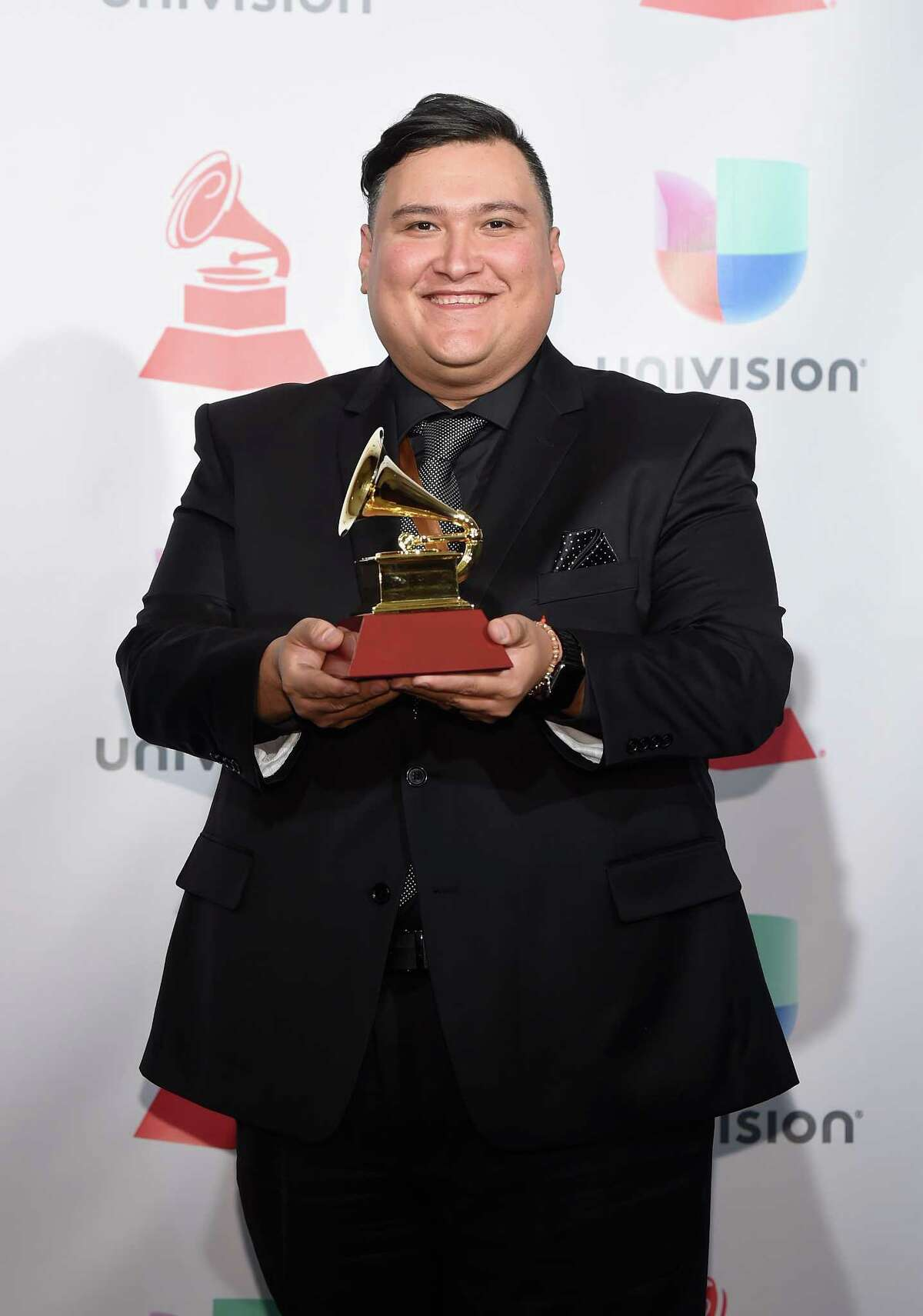 LAS VEGAS, NV - NOVEMBER 16: Juan Trevino poses in the press room during The 18th Annual Latin Grammy Awards at MGM Grand Garden Arena on November 16, 2017 in Las Vegas, Nevada.
