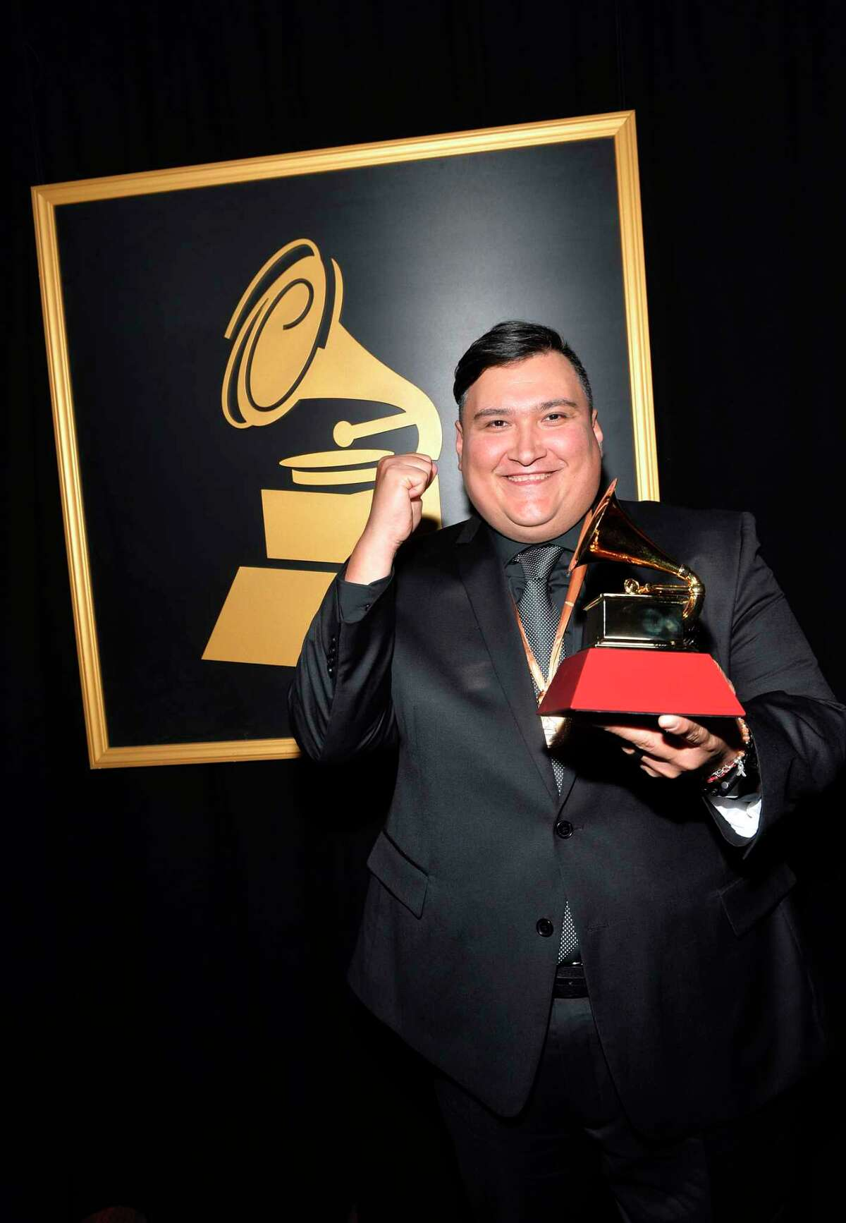 LAS VEGAS, NV - NOVEMBER 16: Juan Trevino poses with the award for Best Regional Song for Siempre Es Asi at the Premiere Ceremony during the 18th Annual Latin Grammy Awards at the Mandalay Bay Convention Center on November 16, 2017 in Las Vegas, Nevada.