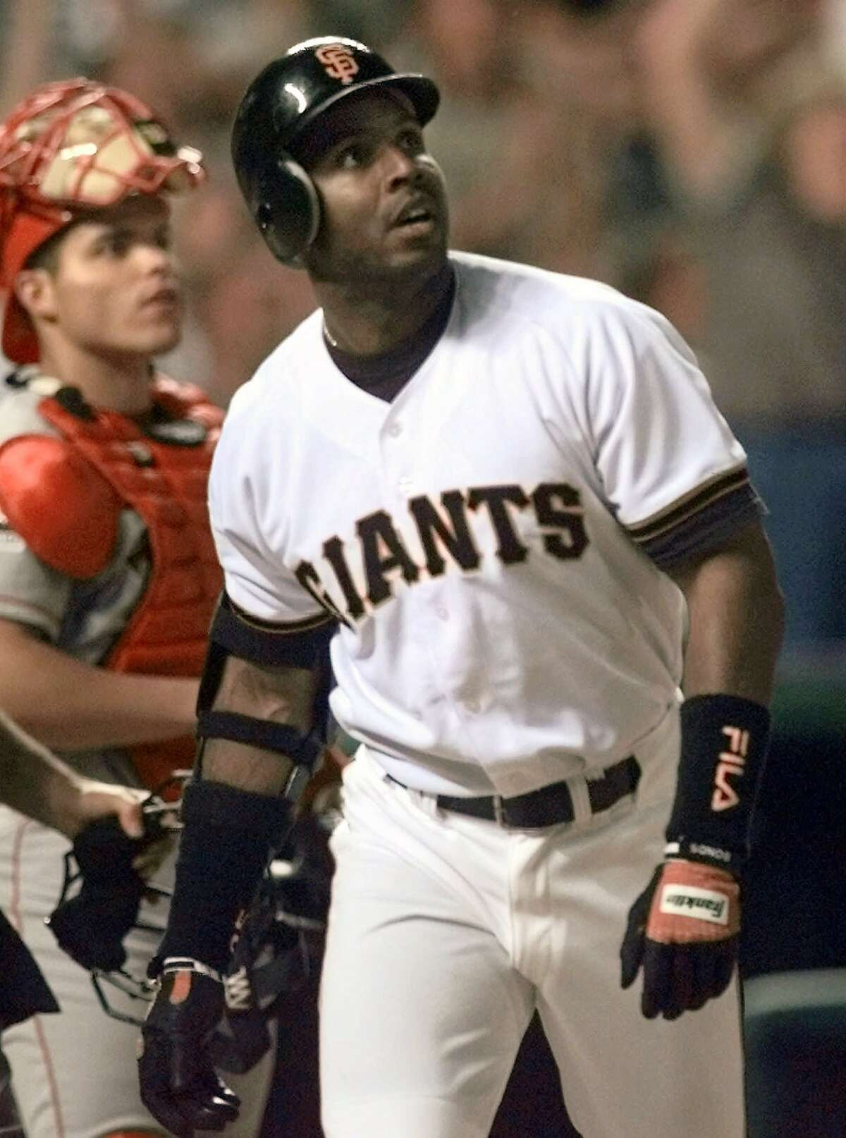 San Francisco Giants' Barry Bonds watches his fifth inning three-run homer during the 69th annual All-Star game at Denver's Coors Field, Tuesday, July 7, 1998. (AP Photo/David Zalubowski)