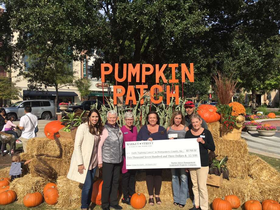 """Pictured (left to right) Noemi Gonzalez, Market Street; Angell Wright, FAITH; Kay Hohman, FAITH; Maggie Marmack, FAITH; Dana Pritchard, The Woodlands Car Club; Phillip Mitchell, The Woodlands Car Club and Barbara Hilton, FAITH. As part of its Change for Charity initiative, Market Street recently donated more than $2,500 to FAITH """"Fighting Cancer"""" in Montgomery County, Inc."""
