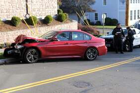 A crashed BMW outside the Metro View apartments on High Street in Milford on Friday, November 17, 2017. Milford police found the body of a man inside a apartment where he barricaded himself after a standoff with police. A resident of the apartment told Hearst Connecticut Media before the man barricading himself, he crashed his red BMW into a utlility pole outside the Metro View apartments. Residenst of the apartment were evacuated around midnight. At around 8 a.m., policd found the unidentified man dead. Police say he committed suicide.