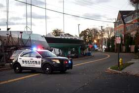 The view down Helwig Street near the Metro View apartments on High Street in Milford on Friday, November 17, 2017. Milford police found the body of a man inside a apartment where he barricaded himself after a standoff with police. A resident of the apartment told Hearst Connecticut Media before the man barricading himself, he crashed his red BMW into a utlility pole outside the Metro View apartments. Residenst of the apartment were evacuated around midnight. At around 8 a.m., policd found the unidentified man dead. Police say he committed suicide.