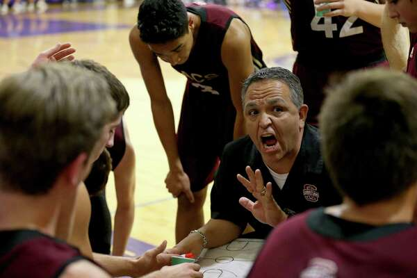 San Antonio Christian head coach John Valenzuela talks with the team during a timeout in the game against Saint Mary's Hall Friday Feb. 3, 2017 at Saint Mary's Hall. San Antonio Christian won 83-78.