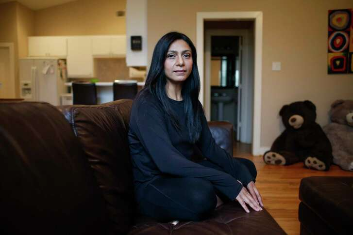 Sam Schmella sits for a portrait after putting her twins to bed Wednesday, Aug. 2, 2017 in Houston. Schmella and her husband went over all charges and doctors before she underwent a scheduled gall bladder surgery and were told they would be covered by insurance. After the surgery, she received a bill for $4,000 because a surgical assistant in the operating room was out of network. ( Michael Ciaglo / Houston Chronicle )