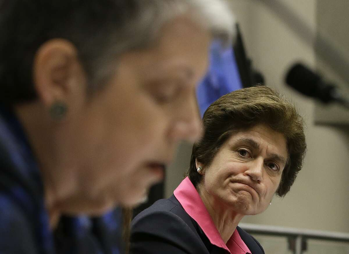 """File - In this May 2, 2017, file photo, State Auditor Elaine Howle, right, looks over as University of California President Janet Napolitano reads her statement concerning the audit conducted by Howle's office, during a hearing of the Joint Legislative Audit Committee in Sacramento, Calif. Top advisers Napolitano improperly interfered in a state audit to tone down critical comments from campus administrators about the president's office, an investigation ordered by the UC regents found. The investigation finds that officials in the president's office instructed UC campuses not to """"air dirty laundry"""" to the state auditor, according to the San Francisco Chronicle, Wednesday, Nov. 15, 2017,, which reviewed the report ahead of its public release on Thursday. (AP Photo/Rich Pedroncelli, File)"""