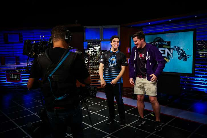 Teammates Emiliano Benny (left) and Jacob McDowell, of team Sizzleurcob laugh as they react to their final win during a televised regional e-sports video game tournament at NBC studios in San Francisco, Calif., on Sunday, Aug. 13, 2017.
