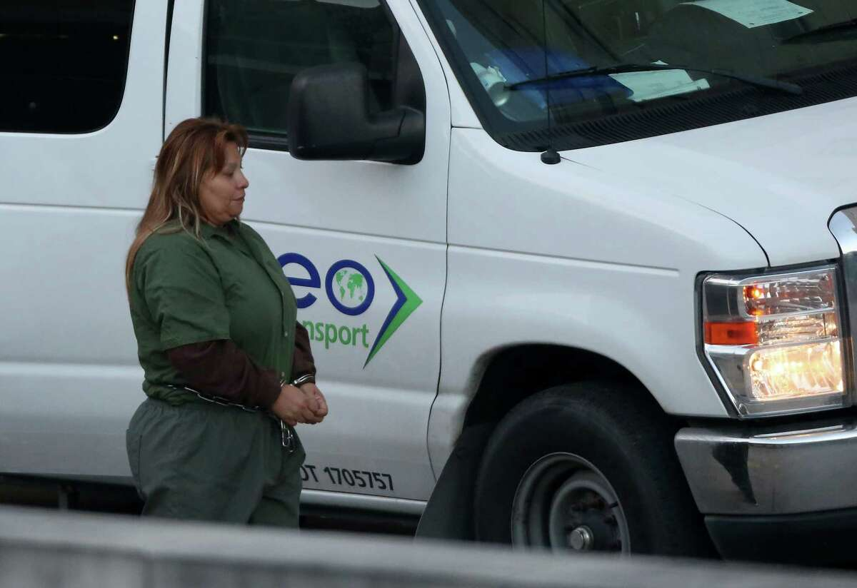"""Maria Angelica """"Patty"""" Moreno-Reyna walks into federal court Friday, Nov. 17, 2017, in Houston. Moreno-Reyna is one of 22 defendants facing federal charges in the sex trafficking operation ran by the Southwest Cholos in the Gulfton section of Houston between 2009 and 2017. FBI agents say brought undocumented women-including a 14-year-old girl--across the border and forced them to work as prostitutes. The names of their pimps were tattooed on their bodies and their families were threatened with violence if they tried to flee, which several women did, only to be hauled back by the gang's enforcers."""