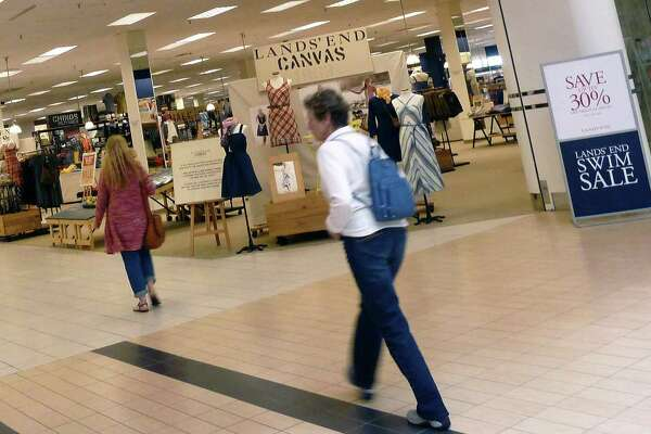 Shoppers walk into Sears in Peabody, Mass. Same-store sales fell 17 percent at Sears last quarter and 13 percent at Kmart. The Hoffman Estates, Illinois-based retailer, which has posted about $11 billion in losses over the past six years, has closed hundreds of locations.