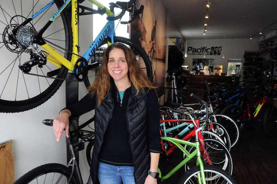 Pacific Cycling and Triathlon president Julie Gabay poses for a photo inside the High Ridge Road cycle shop in Stamford, Conn. on Thursday, Nov. 16, 2017. Photo: Michael Cummo / Hearst Connecticut Media / Stamford Advocate