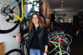 Pacific Cycling and Triathlon president Julie Gabay poses for a photo inside the High Ridge Road cycle shop in Stamford, Conn. on Thursday, Nov. 16, 2017.