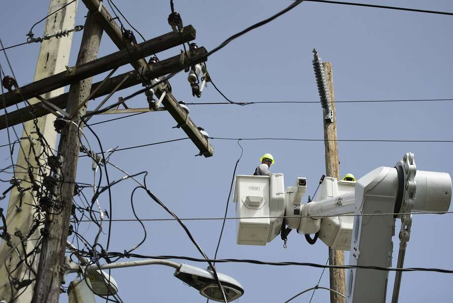 Nearly six dozen Oncor trucks are expected to reaching the northern shore of Puerto Rico on Friday morning, in a coordinated effort to restore power to the island following Hurricane Maria. Photo: Carlos Giusti, Associated Press