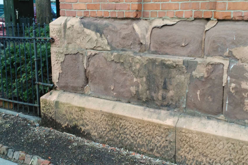 The sandstone foundation blocks were crumbling.