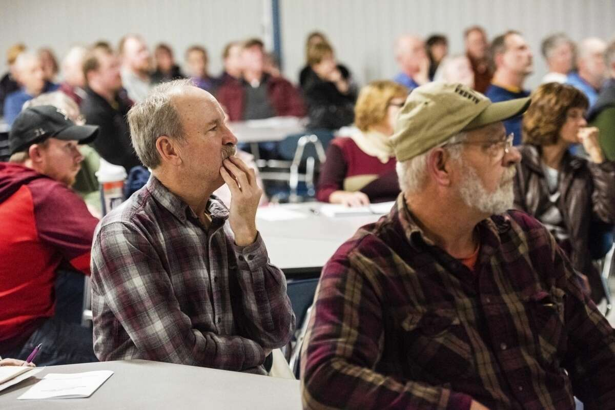 Attendees listen to a presentation about potential hazards and nuisances from turbines during a wind energy informational meeting sponsored by Ingersoll Township Concerned Citizens, on Thursday at Bullock Creek High School (Danielle McGrew Tenbusch/for the Daily News)