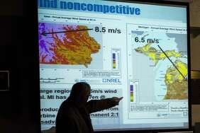 Kevon Martis compares average wind speeds between Iowa and Michigan during a wind energy informational meeting sponsored by Ingersoll Township Concerned Citizens, on Thursday at Bullock Creek High School  (Danielle McGrew Tenbusch/for the Daily News)