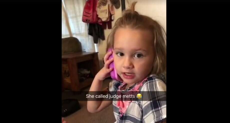 Four-year-old Kynzlee tried to call Montgomery County Precinct 4 Justice of the Peace James Metts to tattle on her sister after hearing Metts speak at her elementary school a week earlier. Photo: Brittney Hammett / Facebook