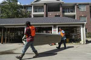 Construction work is carried out at a Houston apartment complex after Hurricane Harvey. Construction jobs rose by 4,500 in Texas during October.