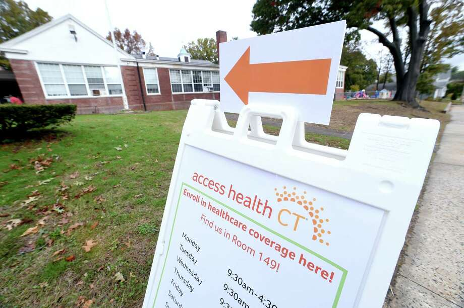 A sign points customers to the Access Health CT office in the Margaret Egan Center in Milford on November 2, 2017. Photo: Arnold Gold / Hearst Connecticut Media / New Haven Register