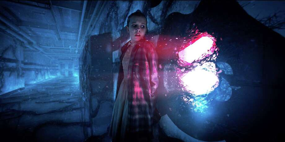 "An eerie moment in Netflix's ""Stranger Things 2"" involving Eleven (Millie Bobbie Brown) and that disturbing portal. According to new data from the video giant, about 12 percent of Americans who watch television shows or movies outside of the home admit to having done so in a public restroom. And 37 percent say they've watched at work. Photo: Netflix / Courtesy Netflix"