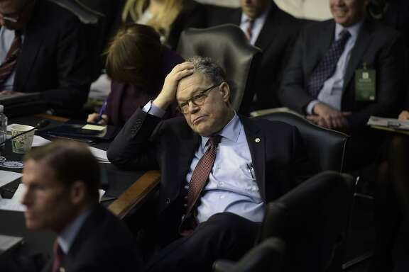(FILES) This file photo taken on March 20, 2017 shows Sen. Al Franken (D-MN)taking a break during the Neil Gorsuch Senate Judiciary Committee confirmation hearing as US President Donald Trump's nominee for the Supreme Court on Capitol Hill in Washington,DC. From the White House to Congress to the Supreme Court, Washington has had its share of sexual scandals.But the #MeToo wave exposing sexual misconduct which began in Hollywood crashed ashore in the US capital this week, triggering an unprecedented slew of allegations, apologies and resignations.Democratic Senator Al Franken said he was sorry after a radio talk show host accused him of forcibly kissing her in 2006 -- two years before voters in Minnesota sent him to the Senate -- and for posing for a picture which showed him groping her breasts while sleeping.  / AFP PHOTO / Brendan SMIALOWSKIBRENDAN SMIALOWSKI/AFP/Getty Images