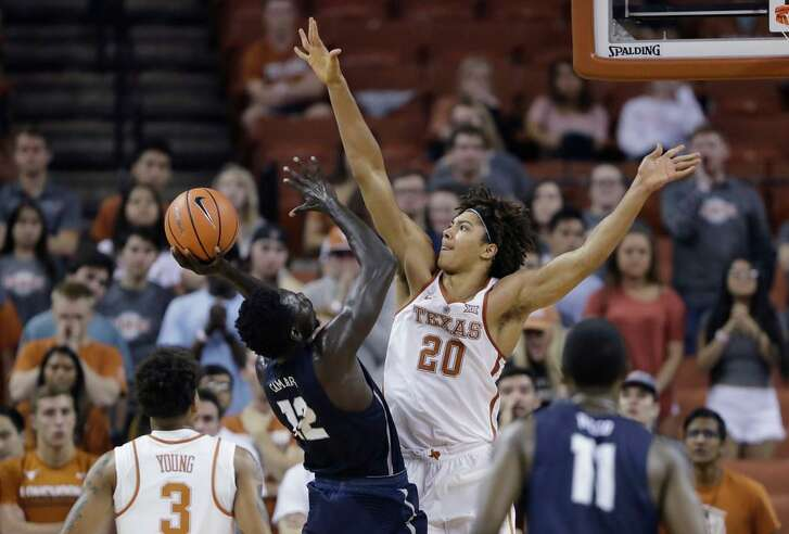 New Hampshire forward Iba Camara (12) looks to shoot over Texas forward Jericho Sims (20) during the second half of a Nov. 14, 2017 game in Austin, Texas. UT won 78-60.