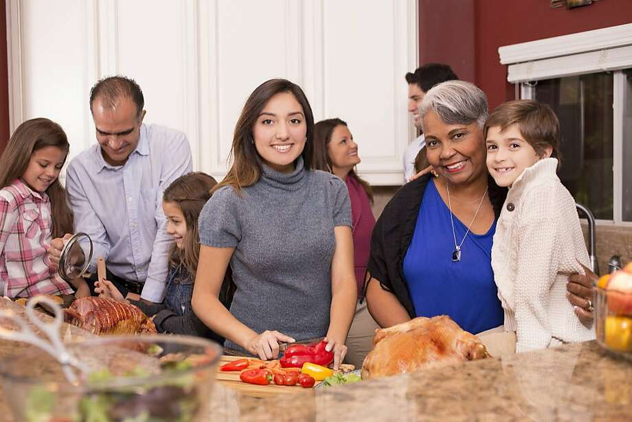 A young woman wonders how difficult it would be to make a thanksgiving meal. Photo: Fstop123, Getty Images