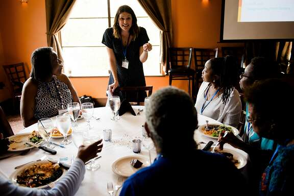 -- PHOTO MOVED IN ADVANCE AND NOT FOR USE - ONLINE OR IN PRINT - BEFORE NOV. 12, 2017. -- Tara Donato, a senior manager at Liveops, speaks to employees at a company event in Durham, N.C., July 18, 2017. Building a network of freelance agents, the company has become the Uber of call centers � and a symbol of a growing model of work. (Erin Hull/The New York Times)