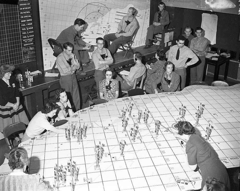 Staff at the information center of the Aircraft Warning Service received calls from spotters, 1942. Photo: Photographer Unknown, The Chronicle
