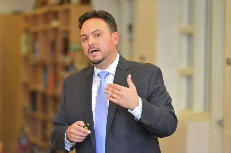 Carlos Reinoso Jr. talks about opioid addiction during an opioid prevention course for the parents of elementary, middle and high school students at West Rocks School on Thursday November 16, 2017 in Norwalk Conn. called Parenting Through the Opioid Crisis and Beyond. Ginger Katz of the Courage to Speak Foundation is presenting the program and is working with Norwalk Public Schools to offer the course at every middle school in the district Photo: Alex Von Kleydorff / Hearst Connecticut Media / Norwalk Hour