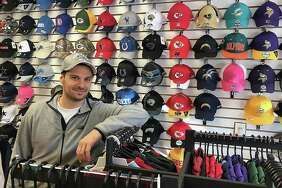 Sal Paladino of East American Sports in his store on South Street in Danbury.