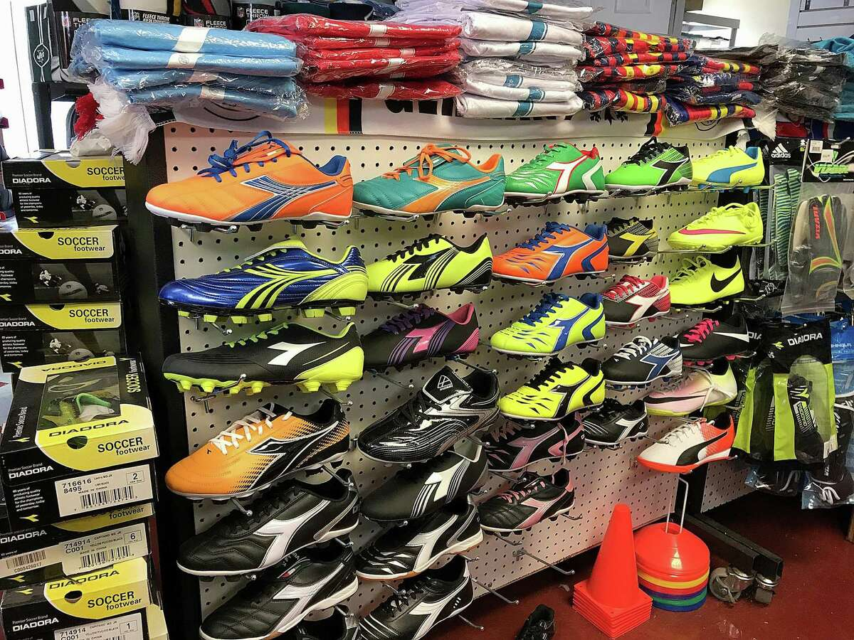 Soccer cleats and shin guards for sale at East American Sports on South Street in Danbury, Conn., pictured on Friday, Nov. 17, 2017.