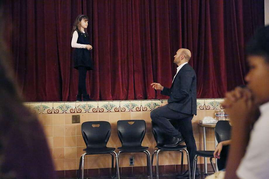 Tenor Michael Fabiano gives Aubrey Sumi, 12, singing tips in his Art Smart program at James Lick Middle School in S.F. Photo: Lea Suzuki, The Chronicle