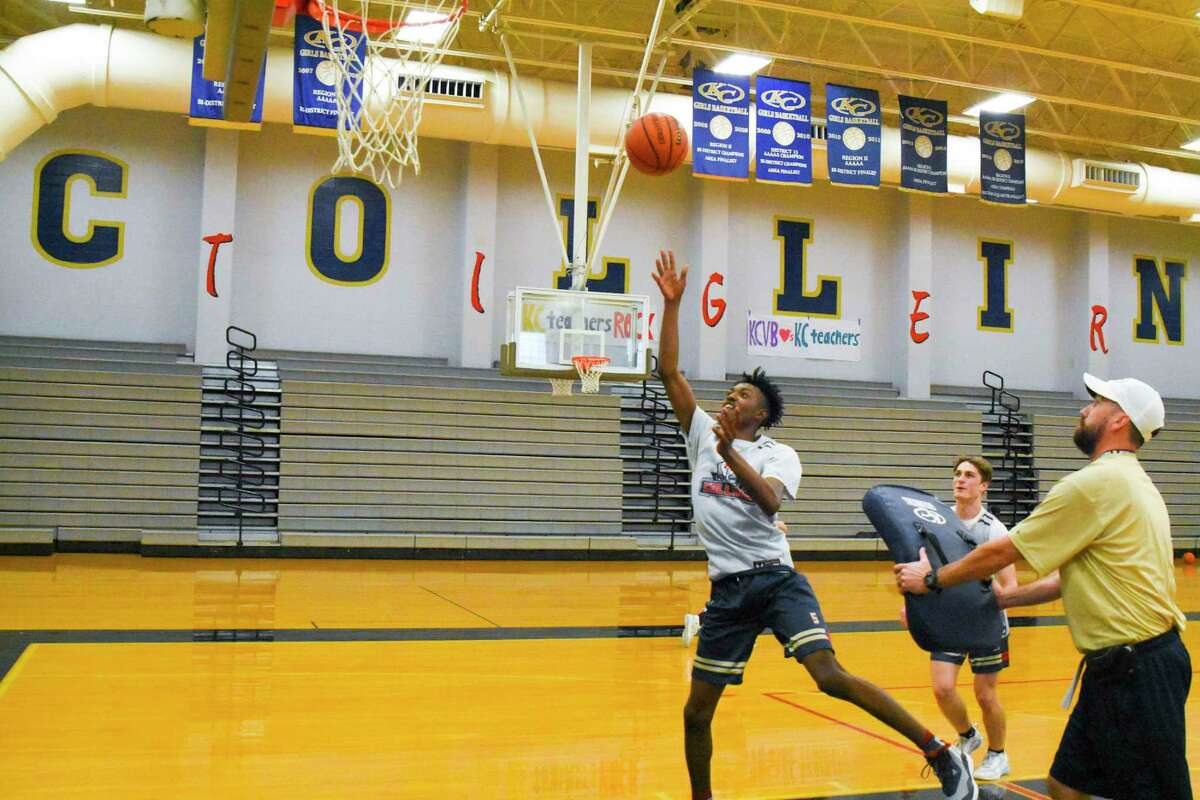 Klein Collins coach Scott Harmatuk watches guard Jordan McCorkle work towards the basket during practice.