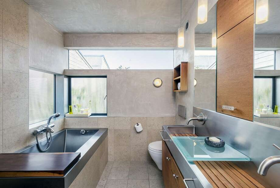 Stainless steel and timber accents finish the master bathroom. / ONLINE_CHECK