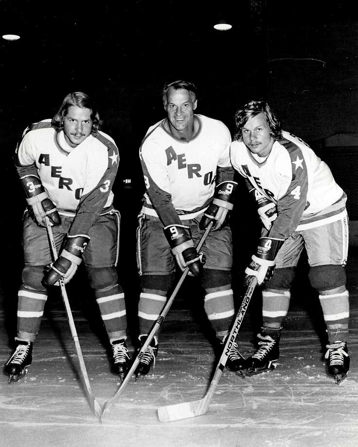 """FILE - In this Aug. 3, 1973, file photo, former Detroit Red Wings great Gordie Howe, center, is flanked by sons Marty, left, and Mark as they try their new Houston Aeros uniforms in St. Clair Shores, Mich. Gordie Howe, the hockey great who set scoring records that stood for decades, has died. He was 88. Son Murray Howe confirmed the death Friday, June 10, 2016, texting to The Associated Press: """"Mr Hockey left peacefully, beautifully, and w no regrets."""" (AP Photo/The Macomb Daily, David Posavetz, File) Photo: David Posavetz, Associated Press"""